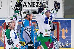 Andrej Hebar (HDD Tilia Olimpija, #84) and Petr Sachl (HDD Tilia Olimpija) celebrating goal during ice-hockey match between HDD Tilia Olimpija and EHC Liwest Black Wings Linz in 18th Round of EBEL league, on November 5, 2010 at Hala Tivoli, Ljubljana, Slovenia. (Photo By Matic Klansek Velej / Sportida.com)