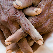 The hands of a laborer: an elderly Rajasthani man's hands clasped together in the village of Nimaj.