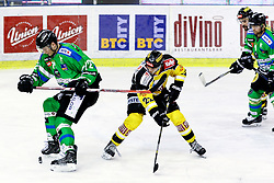 Kristjan Cepon of Olimpija and Julian Grosslercher of Vienna Capitals during ice-hockey match between HDD Telemach Olimpija and EV Vienna Capitals in EBEL league, on January 15, 2016 at Hala Tivoli, Ljubljana, Slovenia. Photo by Morgan Kristan / Sportida