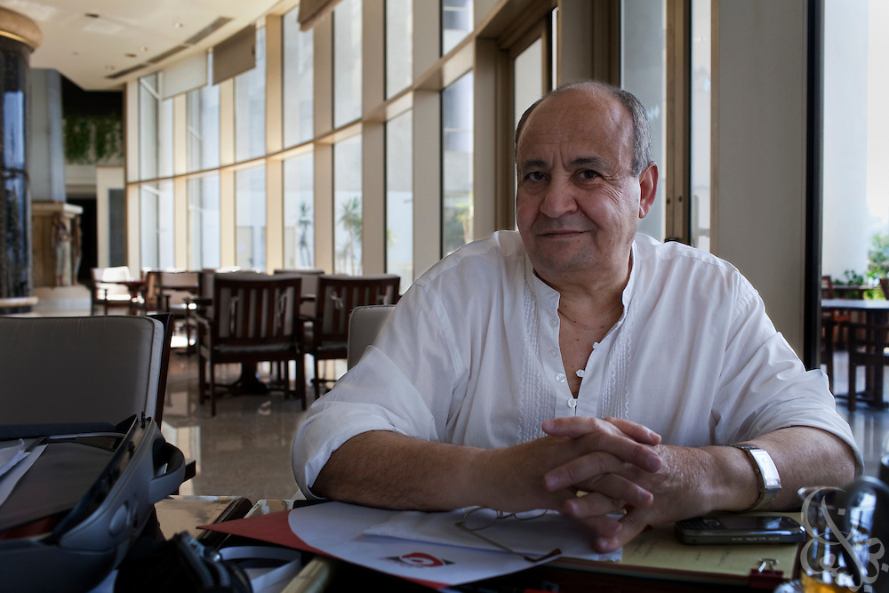 "Famed Egyptian screenwriter Waheed Hamed poses for a portrait as he works at his favorite writing spot at a hotel overlooking the Nile in Cairo, Egypt August 14, 2010.  Hamed , a long time critic of fundamentalist movements, wrote the screen play for the controversial new Egyptian television Ramadan miniseries about the Muslim Brotherhood in Egypt called ""Al Gama'a"".  (Photo by Scott Nelson, for the National)"