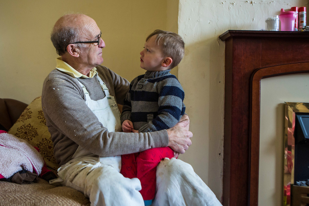 The decoration manager who assists the volunteers also makes time to engage with one of the children. Longton Community Church to improve the lives of those in need in their local community, Leyland, Lancashire.