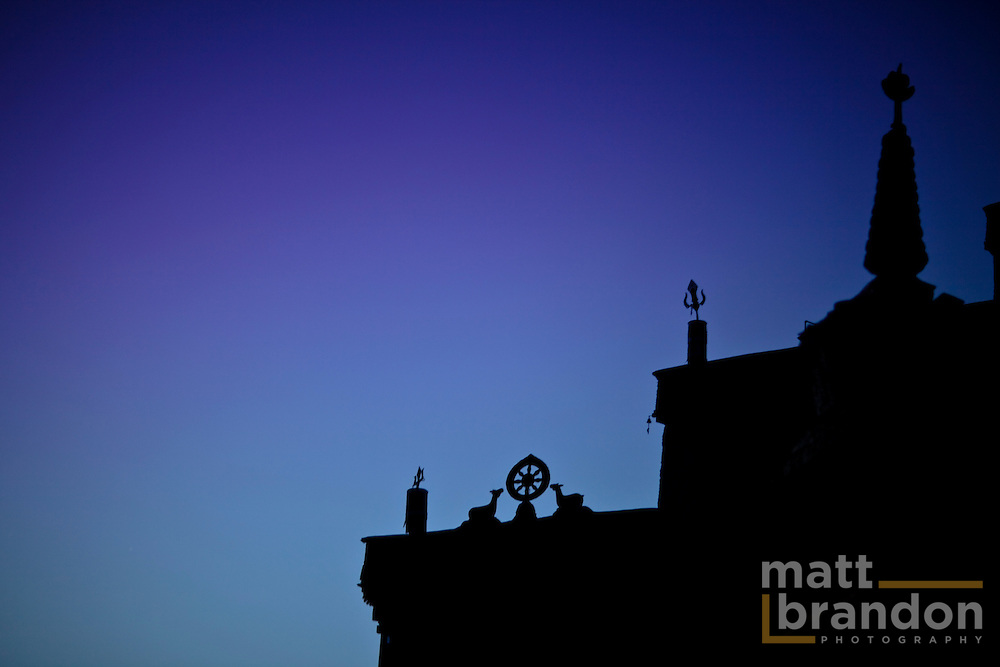 Lamayuru Monastery silhouetted against the morning sky of blue and purple.