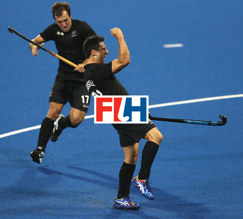 RIO DE JANEIRO, BRAZIL - AUGUST 14:  Kane Russell of New Zealand celebrates after Shea McAlesse scores their second goal during the Men's hockey quarter final match between the Germany and New Zealand on Day 9 of the Rio 2016 Olympic Games at the Olympic Hockey Centre on August 14, 2016 in Rio de Janeiro, Brazil.  (Photo by David Rogers/Getty Images)