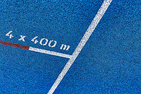 Close up of 400 meter sprint blue tracking field