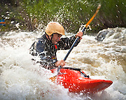 "A kayaker navigates a set of rapids on the ""Race Course"", Rio Grande near Pilar, New Mexico."