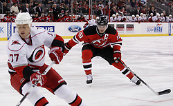 Oct 17, 2009; Newark, NJ, USA; New Jersey Devils right wing Jamie Langenbrunner (15) chases Carolina Hurricanes defenseman Joe Corvo (77) during the second period at the Prudential Center.