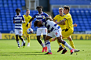 Reading defender Liam Moore (6) is challenged by Barnsley's Dominik Frieser (28) during the EFL Sky Bet Championship match between Reading and Barnsley at the Madejski Stadium, Reading, England on 19 September 2020.