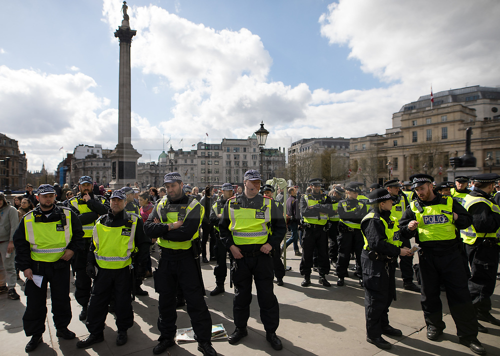 © Licensed to London News Pictures . 01/04/2017 . London , UK . Police at Trafalgar Square . The EDL and Britain First both hold demonstrations in London , opposed by anti-fascist groups , including Unite Against Fascism . Photo credit : Joel Goodman/LNP