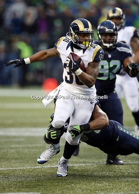 St. Louis Rams running back Todd Gurley II (30) gets tackled by Seattle Seahawks middle linebacker Bobby Wagner (54) as he runs for a fourth quarter gain of 9 yards during the 2015 NFL week 16 regular season football game against the Seattle Seahawks on Sunday, Dec. 27, 2015 in Seattle. The Rams won the game 23-17. (©Paul Anthony Spinelli)