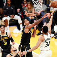 30 March 2018: Milwaukee Bucks forward Giannis Antetokounmpo (34) goes for the layup during the Milwaukee Bucks 124-122 victory over the LA Lakers, at the Staples Center, Los Angeles, California, USA.
