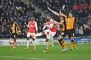 Theo Walcott of Arsenal FC (14) shoots at goal as Hull city players appeal during the The FA Cup fifth round match between Hull City and Arsenal at the KC Stadium, Kingston upon Hull, England on 8 March 2016. Photo by Ian Lyall.