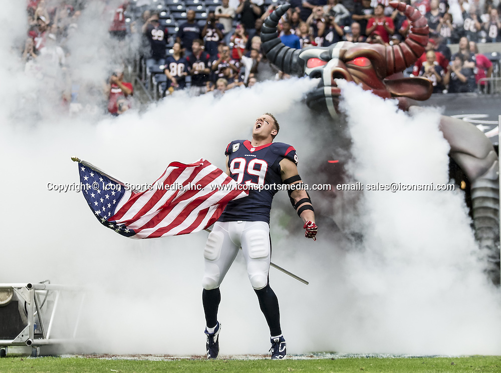 Nov. 17, 2013 - Houston, Texas, U.S. - Houston Texans defensive end J.J. WATT (99) is introduced before the NFL game between the Oakland Raiders and the Houston Texans at Reliant Stadium