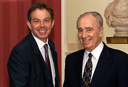 File photo dated 18/07/01 of Tony Blair meeting former Israeli President Shimon Peres, who has died aged 93.