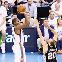 08 May 2016: Oklahoma City Thunder forward Kevin Durant (35) takes a jump shot over San Antonio Spurs guard Manu Ginobili (20) during the Oklahoma City Thunder 111-97 victory over the San Antonio Spurs, during Game Four of the Western Conference Semifinals of the NBA Playoffs at the Chesapeake Energy Arena, Oklahoma City, Oklahoma, USA.