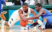 Dec 07, 2011; Birmingham, AL, USA;  Middle Tennessee Blue Blazers guard Bruce Massey (13) goes for the ball along with UAB Quincy Target (25) in Bartow Arena. The Blazers defeated the Blue Raiders 66-56Mandatory Credit: Marvin Gentry-
