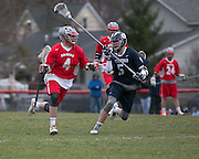 Nick Johnson of Canandaigua is defended by Frank Imburgia of Pittsford during a game in Canandaigua on Saturday, April 11, 2015.