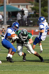 12 October 2013:  D.J. Jones cornered by Kyle Pfister during an NCAA division 3 football game between the North Park vikings and the Illinois Wesleyan Titans in Tucci Stadium on Wilder Field, Bloomington IL