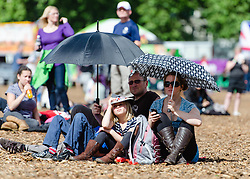 © Licensed to London News Pictures. 05/08/2012. London, UK.     People shade themselves from the sunny weather whilst watching the Olympics on screen at BT London Live, Hyde Park. Photo credit : Richard Isaac/LNP