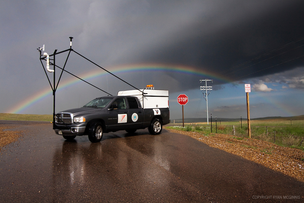 A Scout vehicle with Project Vortex 2 makes a U turn on a highway with a rainbow in the background, June 6, 2009.  Project Vortex 2 is a two year National Science Foundation and NOAA funded science mission to study tornadoes and supercell thunderstorms.