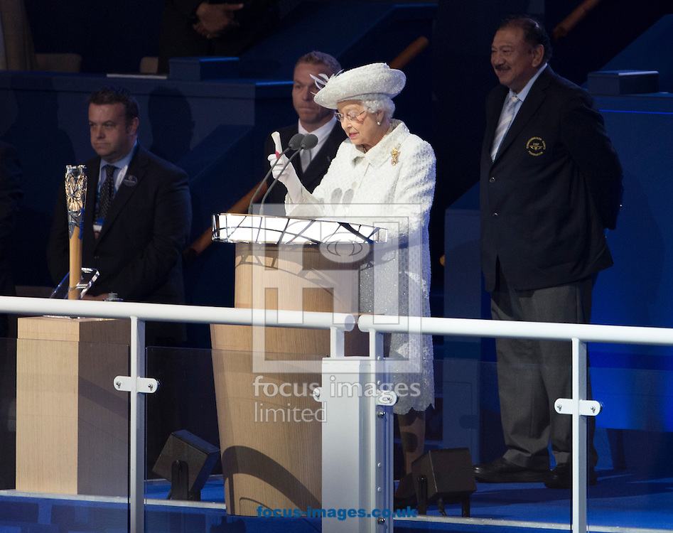 Her Majesty The Queen reads the message from the baton during the Glasgow 2014 Commonwealth Games Opening Ceremony at Celtic Park, Glasgow<br /> Picture by Paul Terry/Focus Images Ltd +44 7545 642257<br /> 23/07/2014