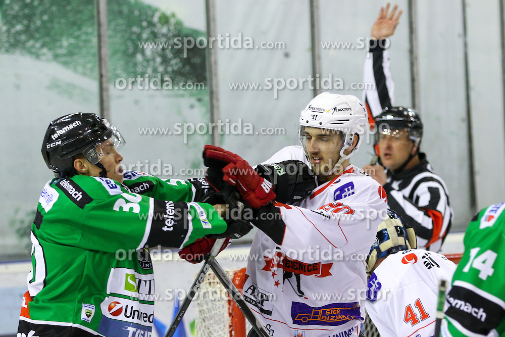 Sebastijan Hadzic of Olimpija vs Marko Tarman of Jesenice during ice hockey game between HDD Telemach Olimpija and SIJ Acroni Jesenice in 1st leg of Finals of Slovenian National Championship 2015, on April 9, 2015 in Hala Tivoli, Ljubljana, Slovenia. Photo by Matic Klansek Velej / Sportida