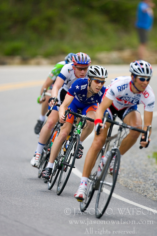The field chases a three man break.  Stage 3 of The Tour of Virginia was a110 mile road race from Bedford, VA to Covington, VA on April 25, 2007. The stage featured the first King of the Mountain points with 2 category three climbs (Three Sisters' Knob and Brushy Mountain) followed by a steep category 1 climb up Warm Springs Mountain - less than 10 miles from the finish.  Formerly known as the Tour of Shenandoah, the ToV has gained National Race Calendar (NRC) status for the first time in its five year history.