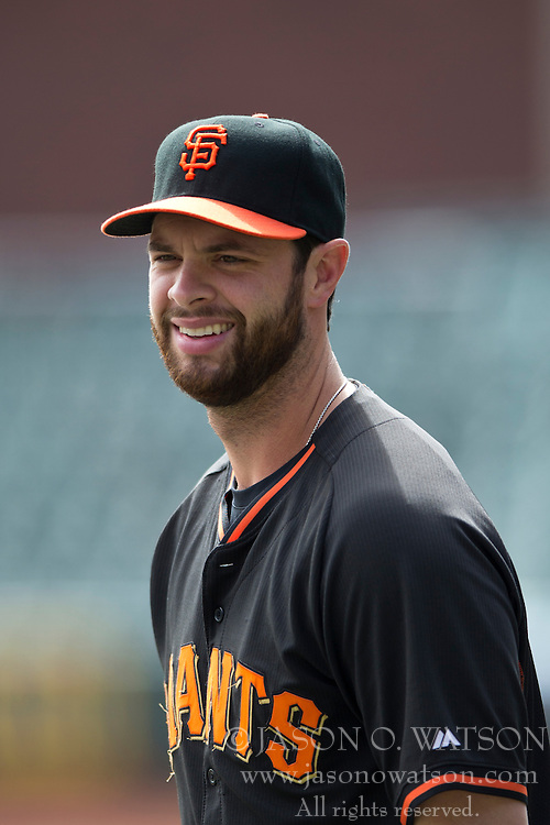 SAN FRANCISCO, CA - APRIL 26:  Brandon Belt #9 of the San Francisco Giants looks on during batting practice before the game against the Cleveland Indians at AT&T Park on April 26, 2014 in San Francisco, California. The San Francisco Giants defeated the Cleveland Indians 5-3.  (Photo by Jason O. Watson/Getty Images) *** Local Caption *** Brandon Belt