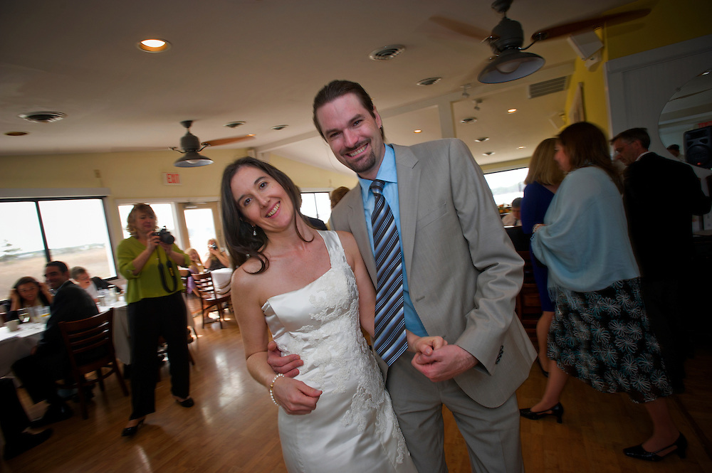 Bethany Beach, Delaware (April 1, 2012) -- Genevieve & Christian get married again, but this time at Bethany Lakes Clubhouse with the reception following at the Blue Coast Seafood Grill.  Photos by Johnny Bivera
