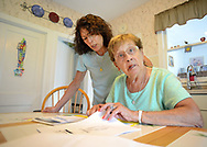 EDITORS NOTE: DIBRINO WAS CONCERNED ABOUT SHOWING HER FACE IN THE IMAGES: Donna Cliggett (left) helps her mother Carmella DiBrino, as they look through paperwork after a scammer bilked her of $11,000 in gift cards  Tuesday, September 05, 2017 in Hatboro, Pennsylvania. Someone pretending to be her grandson called her on the phone and said they needed money to get out of jail and pay a lawyer. She then purchased 11,000 in gift cards at Walmart and read numbers off the back of the cards to the scammer, who hasn't been caught. She is fighting Walmart and her bank to get the money back. (WILLIAM THOMAS CAIN / For The Philadelphia Inquirer)