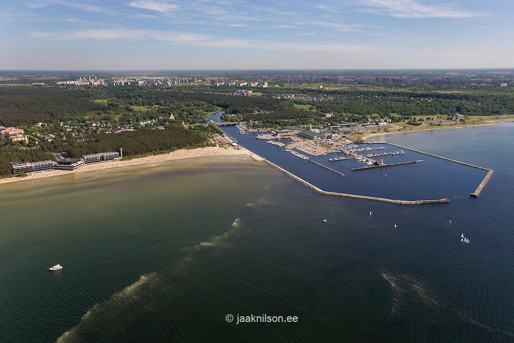 Waterfront Marina at Pirita River Mouth in Tallinn, Estonia. Aerial view. Pier, Breakwater, Jetty and Forest.