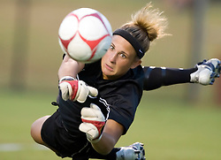 Loyola Greyhounds goalkeeper Brittany Henderson (16) dives off her line to make a save.  The #6 Virginia Cavaliers defeated the Loyola College Greyhounds 4-0 in a NCAA Women's Soccer game held at Klockner Stadium on the Grounds of the University of Virginia in Charlottesville, VA on August 22, 2008.
