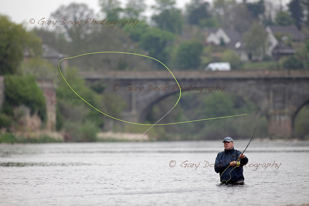 Bob Sanderson and Jonathan Booth (baseball cap) fishing for salmon on the River Tweed at Kelso in the Scottish Borders.