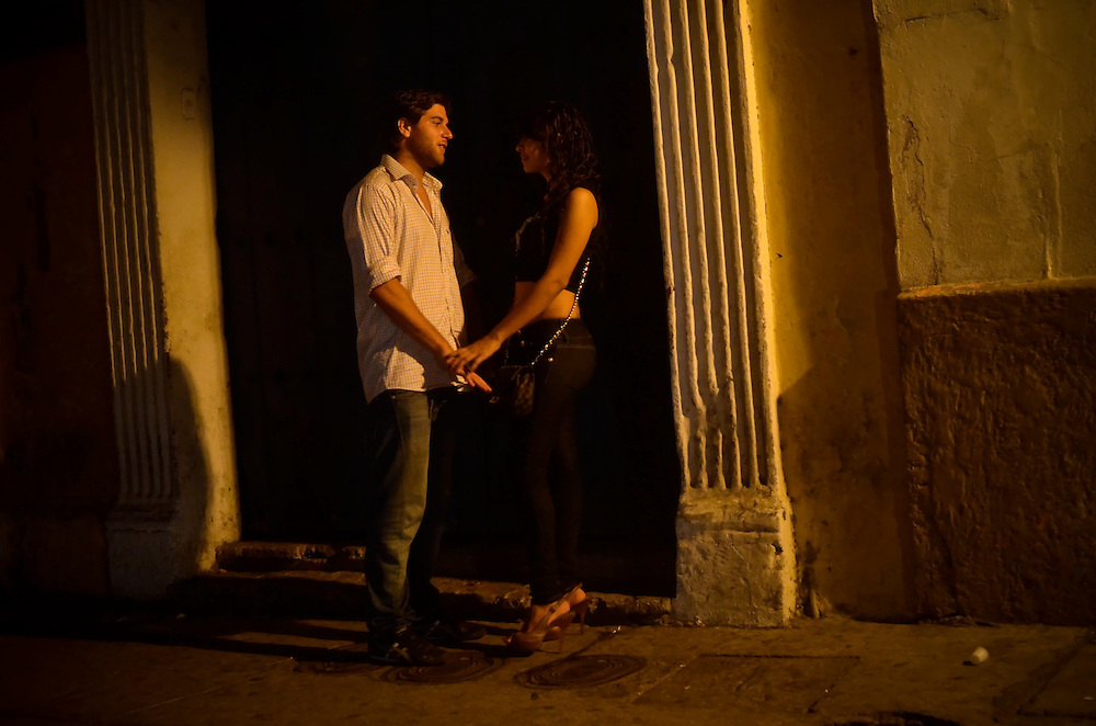 A prostitute and a foreign tourist stand outside of Club Elektra, a club where men go to pick up prostitutes in the historic district in Cartagena, Colombia.  A sex scandal erupted recently when secret service agents were found bringing prostitutes to their hotel rooms while in Cartagena preparing for President Barack Obama's arrival to the Summit of the Americas.