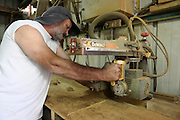 Carpenter Saws wood with a power saw