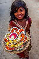 Girl selling puja offerings, Mathura, Uttar Pradesh, India.