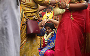 Women wearing flower garlands in the crowd at the parade celebrating the festival of Ganesh Chaturthi, marking the birth of the Hindu god Ganesha, on the streets of the La Chapelle area of the 18th arrondissement of Paris, France, on Sunday 1st September 2019. The annual religious festivities and parade take place near the Ganesha Temple of Paris, or Sri Manicka Vinayakar Alayam Temple, the largest Hindu temple in France. Ganesha is the elephant-headed Hindu God of Beginnings, son of Shiva and Parvati, who represents love and knowledge. Picture by Manuel Cohen