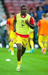 LONDON, ENGLAND - Saturday, September 20, 2014: Liverpool's Mario Balotelli warms-up wearing diamond earrings before the Premier League match against West Ham United at Upton Park. (Pic by David Rawcliffe/Propaganda)