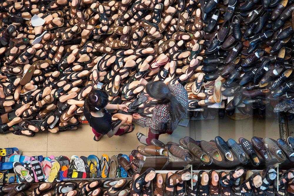 Shoe trade in Dong Xuan market, Hanoi, Vietnam, Southeast Asia