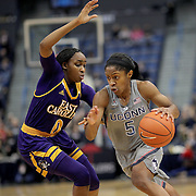 HARTFORD, CONNECTICUT- JANUARY 4:  Crystal Dangerfield #5 of the Connecticut Huskies drives past Justice Gee #0 of the East Carolina Lady Pirates in action during the UConn Huskies Vs East Carolina Pirates, NCAA Women's Basketball game on January 4th, 2017 at the XL Center, Hartford, Connecticut. (Photo by Tim Clayton/Corbis via Getty Images)