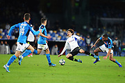 Junya Ito of Genk (C) falls on the ground while fighting for the ball with Allan of Napoli (R) during the UEFA Champions League, Group E football match between SSC Napoli and KRC Genk on December 10, 2019 at Stadio San Paolo in Naples, Italy - Photo Federico Proietti / ProSportsImages / DPPI