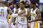 March 14, 2012; Indianapolis, IN, USA; Indiana Pacers power forward David West (21), Indiana Pacers small forward Danny Granger (33) and Indiana Pacers shooting guard Paul George (24) celebrate against Philadelphia 76ers at Bankers Life Fieldhouse. Indiana defeated Philadelphia 111-94. Mandatory credit: Michael Hickey-US PRESSWIRE