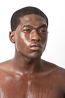Thoughtful young African American man sweating over white background