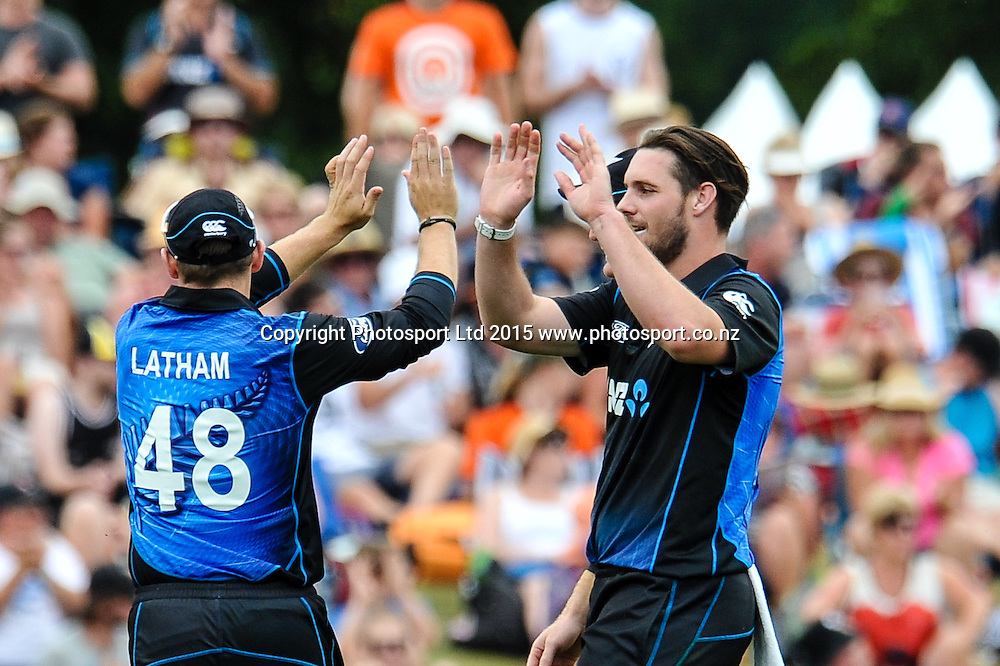 Mitchell McClenaghan  celebrates a wicket with Tom Latham of the Black Caps  in the first ODI Cricket match, Black Caps v Sri Lanka, at Hagley Oval, Christchurch, 11 January 2015. Photo:John Davidson/www.photosport.co.nz