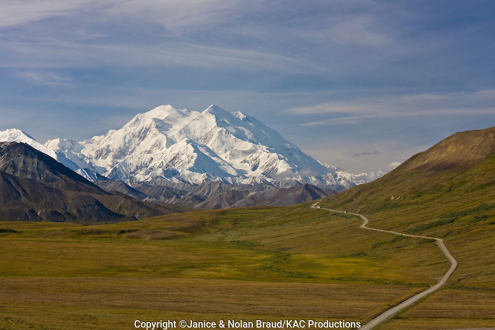 "Mt. McKinley - known by Alaskans and native americans as Denali (meaning The High One) is the tallest mountain in North America at 20,320 feet. It is rare to see the top of Denali without clouds as tall mountains often ""make their own weather."""