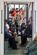 27 DECEMBER 2008 -- PHOENIX, AZ: At 10:08AM People ride a northbound train out of downtown Phoenix Saturday. Metro Light Rail started running Saturday, Dec. 28. The light rail line is 20 miles long and cost $1.4 billion dollars. PHOTO BY JACK KURTZ