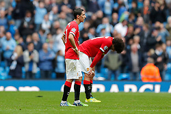 Angel Di Maria and Marouane Fellaini of Manchester United look dejected after Manchester City win 1-0 - Photo mandatory by-line: Rogan Thomson/JMP - 07966 386802 - 02/11/2014 - SPORT - FOOTBALL - Manchester, England - Etihad Stadium - Manchester City v Manchester United - Barclays Premier League.