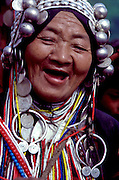 Despite a hard life, laughter surrounds a matron of the Akah tribe in northern Thailand.