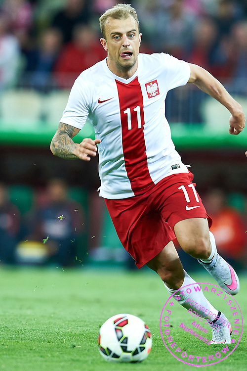 Kamil Grosicki from Poland controls the ball during international friendly soccer match between Poland and Greece at PGE Arena Stadium on June 16, 2015 in Gdansk, Poland.<br /> Poland, Gdansk, June 16, 2015<br /> <br /> Picture also available in RAW (NEF) or TIFF format on special request.<br /> <br /> For editorial use only. Any commercial or promotional use requires permission.<br /> <br /> Adam Nurkiewicz declares that he has no rights to the image of people at the photographs of his authorship.<br /> <br /> Mandatory credit:<br /> Photo by &copy; Adam Nurkiewicz / Mediasport