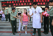 ZHENGZHOU, CHINA - AUGUST 19: (CHINA OUT)<br /> <br /> A Girl Has A Big Leg<br /> <br /> Sun Jingjing walks out of the Armed Police Corps Hospital of Henan on August 19, 2013 in Zhengzhou, Henan Province of China. 22-year-old Sun Jingjing, who was born with congenital angiolipoma in her right leg, underwent a leg-amputation surgery on July 23. And the hospital will offer her a prosthesis free of charge in three months. Sun Jingjing comes from a poor family in Baibi town of Anyang city, Henan province. She had never received any adequate treatment before, the circumference of her right leg was 85cm when her story was published by local media two months ago. Her father died by uremia 12 years ago, and her mother is suffering from esophageal cancer. They live on subsistence allowance from the local government. <br /> ©Exclusivepix