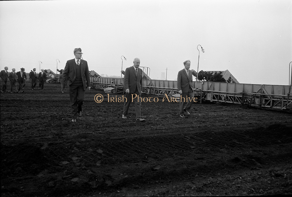 23/09/1963<br /> 09/23/1963<br /> 23 September 1963<br /> Minister sees advances in peat productivity by Bord na Mona at Timahoe, Co. Kildare. Picture shows Mr Dermot C. Lawlor, (centre) Managing Director, Bord na Mona showing the Minister for Transport and Power, Mr Erskine Childers (right) an automatic sod collector at Timahoe turf works, during the minister's end of season visit to Bord na Mona installations.